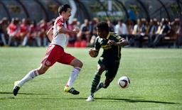 Sep 20, 2015; Portland, OR, USA; New York Red Bulls midfielder Sacha Kljestan (16) brings the ball up the field during the first half of the game against the Portland Timbers at Providence Park. Steve Dykes-USA TODAY Sports