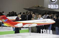 Visitors look at a model of the ARJ21 regional jet from Commercial Aircraft Corp of China (COMAC) at the Aviation Expo China 2015 in Beijing, China, September 16, 2015. REUTERS/Jason Lee