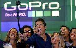 GoPro Inc's founder and CEO Nick Woodman (C) celebrates GoPro Inc's IPO with family and staff at the Nasdaq Market Site in New York City, June 26, 2014. REUTERS/Mike Segar