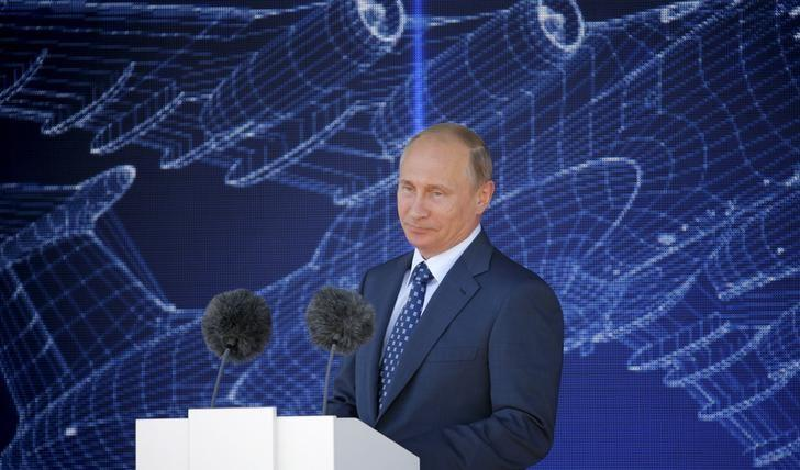 Russian President Vladimir Putin arrives to deliver his speech during an opening ceremony of the MAKS International Aviation and Space Salon in Zhukovsky, outside Moscow, Russia, August 25, 2015. REUTERS/Maxim Shemetov