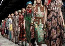 Models parade at the end of Gucci's presentation. REUTERS/Alessandro Garofalo