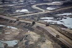 Giant dump trucks haul raw tar sands at the Suncor tar sands mining operations near Fort McMurray, Alberta, September 17, 2014. REUTERS/Todd Korol