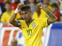 Sep 8, 2015; Foxborough, Mass, USA; Brazil forward Neymar Jr. (10) celebrates after he scored on a penalty kick during the second half of Brazil's 4-1 win over the United States at Gillette Stadium. Mandatory Credit: Winslow Townson-USA TODAY Sports