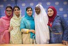Nobel Peace Prize winner Malala Yousafzai (C) and her friends and fellow activists Kainat Riaz (L), Shazia Ramzan (2nd L), both from Pakistan, Amina Yusuf (2nd R) from Nigeria, and Salam Masri (R) from Syria, smile while at a news conference after speaking at the United Nations General Assembly at U.N. headquarters in New York, September 25, 2015. REUTERS/Darren Ornitz