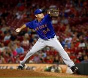 Sep 25, 2015; Cincinnati, OH, USA;New York Mets relief pitcher Tim Stauffer throws against the Cincinnati Reds in the ninth inning at Great American Ball Park. The Mets won 12-5. Mandatory Credit: David Kohl-USA TODAY Sports