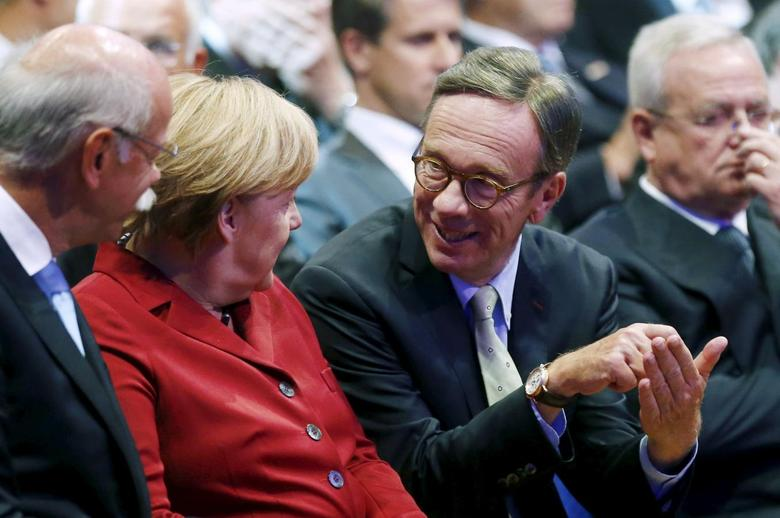 German Chancellor Angela Merkel talks to President of the German Automotive Industry Association (VDA) Matthias Wissmann (2nd R) while sitting next to Volkswagen's then-CEO Martin Winterkorn (R) during the official opening of the Frankfurt Motor Show (IAA) in Frankfurt in this September 12, 2013 file photo.  REUTERS/Kai Pfaffenbach/Files