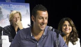 Actors Adam Sandler (C) David Spade (back) and Selena Gomez attend a news conference to promote the film ' Hotel Transylvania ' during the 37th Toronto International Film Festival,  September 8, 2012.  REUTERS/Fred Thornhill