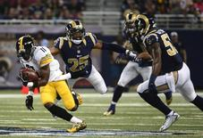 Sep 27, 2015; St. Louis, MO, USA; Pittsburgh Steelers wide receiver Markus Wheaton (11) carries the ball as St. Louis Rams strong safety T.J. McDonald (25) leaps to tackle him during the first half at the Edward Jones Dome. Mandatory Credit: Jeff Curry-USA TODAY Sports