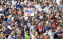 Sep 27, 2015; Foxborough, MA, USA; New England Patriots fans react after quarterback Tom Brady (12) throws his 400th touchdown pass against the Jacksonville Jaguars in the second quarter at Gillette Stadium. Mandatory Credit: David Butler II-USA TODAY Sports