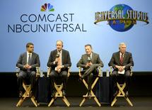 Comcast Corp. Chairman and CEO Brian Roberts (2nd L), Universal Studios Japan Chairman and CEO Glenn Gumpel (2nd R), and unidentified officials attend their joint news conference in Osaka, western Japan, in this photo taken by Kyodo September 28, 2015.  REUTERS/Kyodo