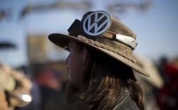 An enthusiast wears a Volkswagen logo on his hat while attending the Wasteland Weekend event in California City, California September 26, 2015.  REUTERS/Mario Anzuoni