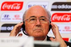 FIFA President Sepp Blatter arrives attends a media briefing to discuss the Confederations Cup and the latest preparations for next year's World Cup finals in Brazil, in Rio de Janeiro in a July 1, 2013 file photo. REUTERS/Sergio Moraes/Files