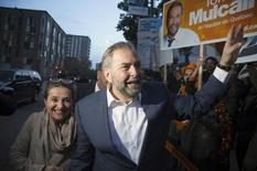 New Democratic Party leader Thomas Mulcair and his wife Catherine Pinhas greet supporters as they arrive for the French language leaders' debate in Montreal, Quebec October 2, 2015. REUTERS/Christinne Muschi