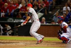 Oct 2, 2015; Arlington, TX, USA; Los Angeles Angels center fielder Mike Trout (27) hits a triple in the ninth inning against the Texas Rangers at Globe Life Park in Arlington. Los Angeles won 2-1. Mandatory Credit: Tim Heitman-USA TODAY Sports