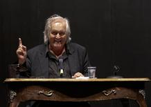 Swedish author Henning Mankell gestures during a news conference in Berlin June 3, 2010.  REUTERS/Tobias Schwarz