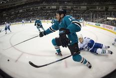 September 29, 2015; San Jose, CA, USA; San Jose Sharks left wing Raffi Torres (13) fights for the puck defended by Vancouver Canucks right wing Adam Cracknell (24) during the first period at SAP Center at San Jose. Mandatory Credit: Kyle Terada-USA TODAY Sports