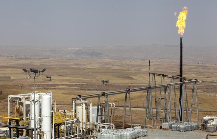 A flame rises from a chimney at Taq Taq oil field in Arbil, in Iraq's Kurdistan region, August 16, 2014. Picture taken August 16, 2014. REUTERS/Azad Lashkari