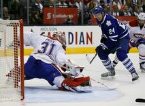 Oct 7, 2015; Toronto, Ontario, CAN; Toronto Maple Leafs forward Peter Holland (24) watches his shot on Montreal Canadiens goaltender Carey Price (31) just miss the net during the second period at the Air Canada Centre.  John E. Sokolowski-USA TODAY Sports