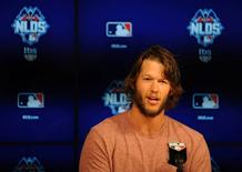 October 8, 2015; Los Angeles, CA, USA; Los Angeles Dodgers starting pitcher Clayton Kershaw speaks with media following workouts before game one of the NLDS at Dodger Stadium. Mandatory Credit: Gary A. Vasquez-USA TODAY Sports
