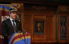Rugby Union - United States of America - Rugby World Cup Welcome Ceremony - HM Naval Base Portsmouth - 13/9/15 USA captain Chris Wyles speaks in front of a portrait of Admiral Nelson in the Ward Room of HMS Nelson during the Welcome ceremony Action Images via Reuters / John Sibley Livepic