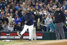 Jun 2, 2015; Seattle, WA, USA; Seattle Mariners manager Lloyd McClendon (23) kicks dirt after being ejected during the third inning against the New York Yankees at Safeco Field. Third base umpire Tony Randazzo (11) stands at right. Mandatory Credit: Joe Nicholson-USA TODAY Sports