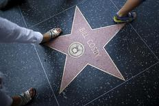 People walk over Bill Cosby's star of the Hollywood Walk of Fame in Los Angeles, California, United States July 9, 2015.  REUTERS/Lucy Nicholson