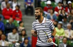 Benoit Paire of France reacts after winning a point against Japan's Kei Nishikori during their men's singles semifinal match at the Japan Open tennis championships in Tokyo October 10, 2015.   REUTERS/Thomas Peter