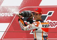 Honda MotoGP rider Dani Pedrosa of Spain sprays champagne after winning the Japanese Grand Prix at the Twin Ring Motegi circuit in Motegi, north of Tokyo, Japan, October 11, 2015. REUTERS/Issei Kato
