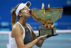 Garbine Muguruza of Spain poses for photographs with her trophy during the award ceremony after winning the women's singles final match against Timea Bacsinszky of Switzerland at the China Open Tennis Tournament in Beijing, China, October 11, 2015. REUTERS/Kim Kyung-Hoon