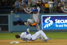 New York Mets shortstop Ruben Tejada (11) collides with Los Angeles Dodgers second baseman Chase Utley (26) at second base during the seventh inning in game two of the NLDS at Dodger Stadium. Mandatory Credit: Jayne Kamin-Oncea-USA TODAY Sports