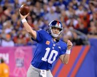 Oct 11, 2015; East Rutherford, NJ, USA; New York Giants quarterback Eli Manning (10) throws the ball against the San Francisco 49ers in the first half at MetLife Stadium. Mandatory Credit: Robert Deutsch-USA TODAY Sports