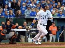 Oct 9, 2015; Kansas City, MO, USA; Kansas City Royals left fielder Alex Gordon hits a single against the Houston Astros in the 8th inning in game two of the ALDS at Kauffman Stadium. Mandatory Credit: Peter G. Aiken-USA TODAY Sports