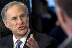 Texas governor Greg Abbott speaks during an interview on the floor of the New York Stock Exchange July 14, 2015. REUTERS/Brendan McDermid