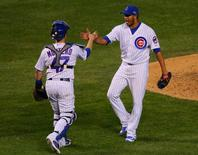 Chicago Cubs relief pitcher Hector Rondon (56) celebrates with catcher Miguel Montero (47) after defeating the St. Louis Cardinals 8-6 in game three of the NLDS at Wrigley Field. Mandatory Credit: Dennis Wierzbicki-USA TODAY Sports