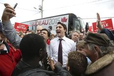 Liberal leader Justin Trudeau greets supporters during a campaign stop in St. Catharines, Ontario October 14, 2015.  REUTERS/Chris Wattie