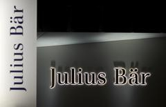 The logo of Swiss private bank Julius Baer is pictured on the company's branch in Lausanne in this November 13, 2014 file photo.  REUTERS/Denis Balibouse/Files