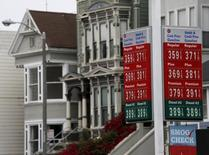 A sign displaying the prices of gasoline is seen at a filling station in San Francisco, California July 22, 2015. REUTERS/Robert Galbraith