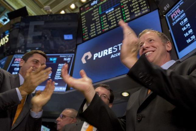 Pure Storage Inc. CEO Scott Dietzen (R) celebrates his company's IPO on the floor of the New York Stock Exchange October 7, 2015. REUTERS/Brendan McDermid