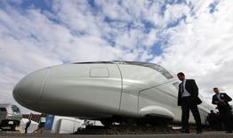 Visitors walk past to a Bombardier ZEFIRO 380 high speed trains at the Innotrans 'International Trade Fair for Transport Technology - Innovative Components, Vehicles, Systems' in Berlin September 21, 2010.  REUTERS/Fabrizio Bensch