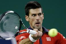 Novak Djokovic of Serbia returns a shot to Bernard Tomic of Australia during their men's singles quarter-final match at the Shanghai Masters tennis tournament in Shanghai, China, October 16, 2015. REUTERS/Aly Song