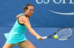 Jelena Jankovic of Serbia returns a shot against Oceane Dodin of France on day one of the 2015 U.S. Open tennis tournament at USTA Billie Jean King National Tennis Center. Mandatory Credit: Jerry Lai-USA TODAY Sports  / Reuters