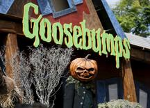 "A person dressed as a pumpkin monster poses at the premiere of the film ""Goosebumps,"" in Los Angeles, California October 4, 2015. REUTERS/Danny Moloshok"