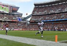 Denver Broncos wide receiver Emmanuel Sanders (10) carries the ball for a touchdown after the catch as Cleveland Browns cornerback Jordan Poyer (33) defends in the fourth quarter at FirstEnergy Stadium. Mandatory Credit: James Lang-USA TODAY Sports