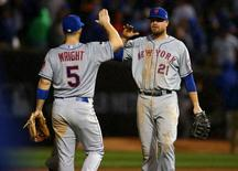 New York Mets third baseman David Wright (5) celebrates with first baseman Lucas Duda (21) the 5-2 victory against the Chicago Cubs following game three of the NLCS at Wrigley Field. Mandatory Credit: Jerry Lai-USA TODAY Sports