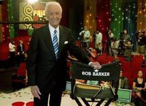 "Host Bob Barker poses next to his chair before a news conference after the taping of his final episode of the game show ""The Price Is Right"" in Los Angeles June 6, 2007. REUTERS/Fred Prouser  (UNITED STATES) - RTR1QJ6R"