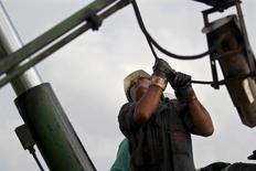 A technician of Cuba's state-run CUPET works on an oil pump in Mayabeque province, Cuba, October 15, 2015. REUTERS/Enrique de la Osa