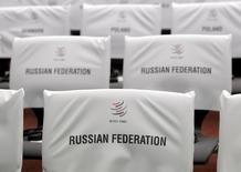 Сидения для участников церемонии по случаю принятия РФ в ВТО. Женева, 16 декабря 2011 года. Украина начала первый спор с Россией в рамках Всемирной торговой организации, протестуя против ограничений на поставки продукции, предназначенной для железных дорог, сообщила ВТО. REUTERS/Denis Balibouse