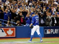 Oct 21, 2015; Toronto, Ontario, CAN; Toronto Blue Jays starting pitcher Marco Estrada (25) reacts after leaving the game during the eighth inning against the Kansas City Royals in game five of the ALCS at Rogers Centre. Mandatory Credit: John E. Sokolowski-USA TODAY Sports