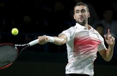Marin Cilic of Croatia hits a return against Evgeny Donskoy of Russia during their men's singles semi-final match at the Kremlin Cup tennis tournament in Moscow, Russia October 24, 2015. REUTERS/Maxim Shemetov
