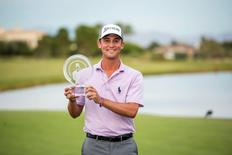 Smylie Kaufman holds the trophy after winning the Shriners Hospitals for Children Open at TPC Summerlin at TPC Summerlin. Mandatory Credit: Joshua Dahl-USA TODAY Sports